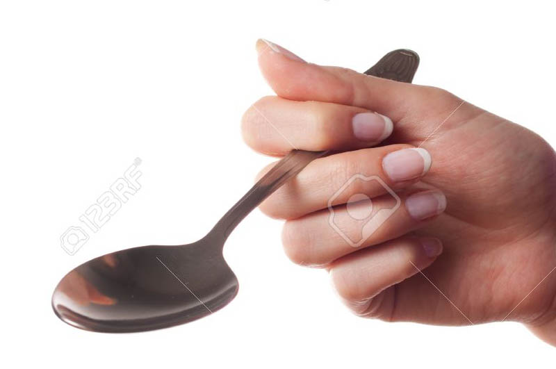 9130085 Woman hand holding spoon on white background Stockfoto1