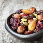 trail mix in small bowl with cranberries almonds seeds and hazelnuts