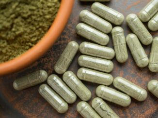 supplement kratom green capsules and powder on royalty free image 975647294 1555080698